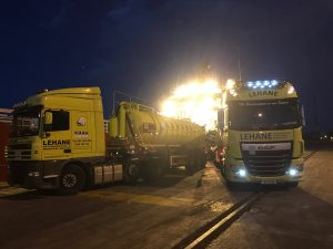 Night works removing waste from ship